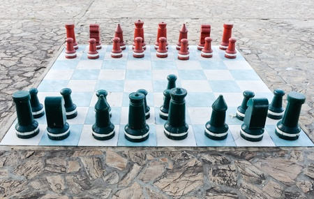Big size wooden chess on the garden of hotel photo
