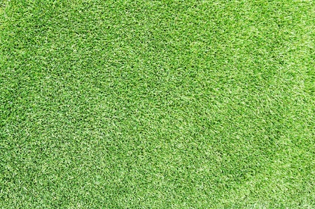 Green artificial grass area of the football stadium. photo