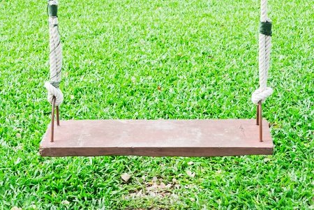 Wooden swing on the garden of hotel.  photo