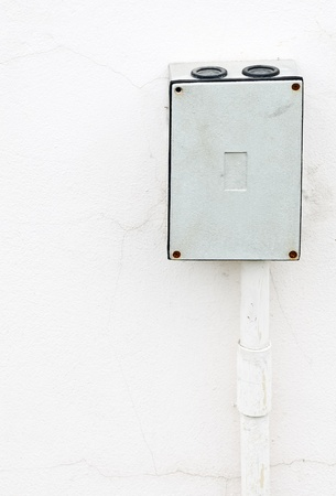 Electric box on the white wall of industry. photo