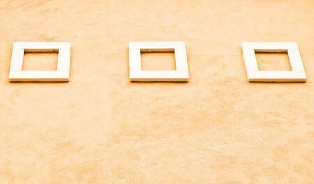 Modern white frame on the orange wall inside the house. Stock Photo - 10915517