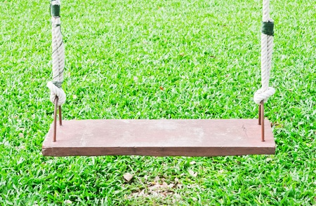 Wooden swing on the garden of hotel. Stock Photo - 11202141
