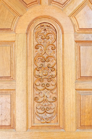Floral motifs carved on the old wooden doors. Stock Photo