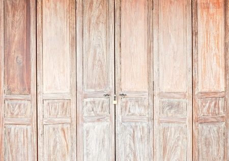 Old wooden door at the ancient market in countryside of Thailand. photo