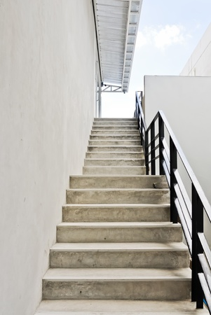 Modern white stair up to the restaurant in the urban city. photo