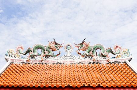 Twin dragon on the Chinese temple roof. photo