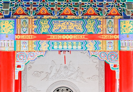 Colorful painting on main gate of Chinese temple. photo