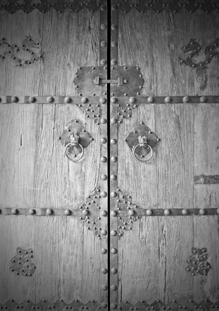 Old wooden door in chinese style of famous temple. photo