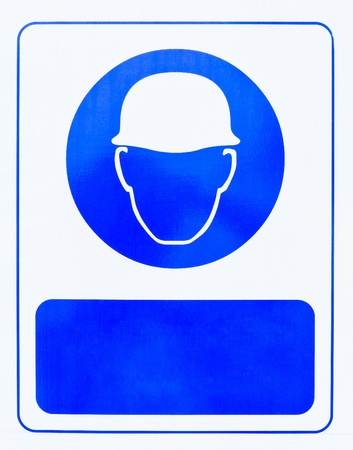 The blue helmet symbol in front of the construction sites of large building. photo