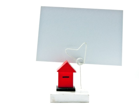 Small postbox model for show the postcard on white background. photo