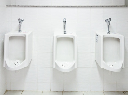 White urinal in the restroom of hotel.