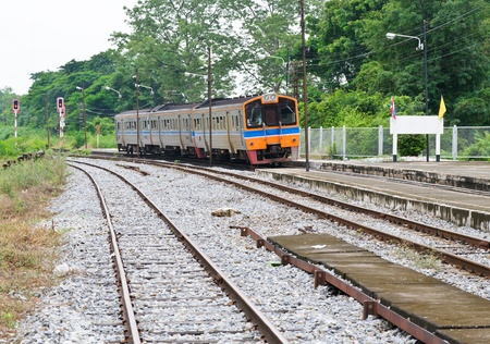 Diesel railcar is going to the platfrom of  station,Thailand photo