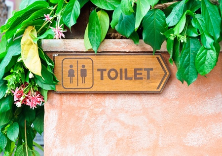 Toilet direction board in the garden. Stock Photo
