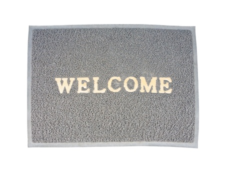 Old welcom doormat on the white background. photo