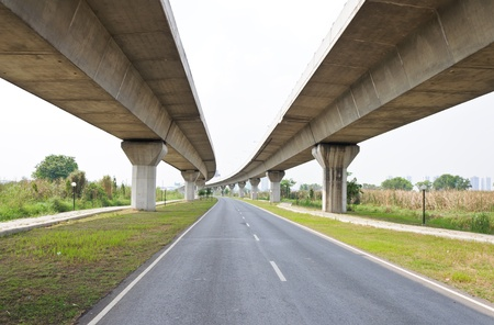 infrastructure buildings: Empty asphalt road under the new expressway line.