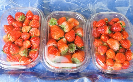 plastic container: Fresh strawberry in the pack on market. Stock Photo