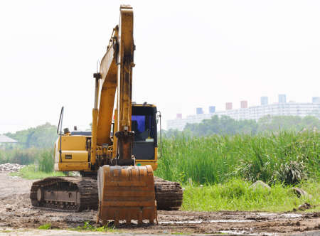 Large excavators were parked in front of the building. photo