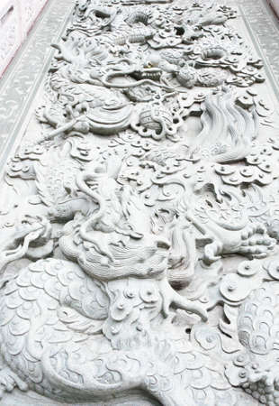 Carved white dragons on the stairs of Chinese temple  photo