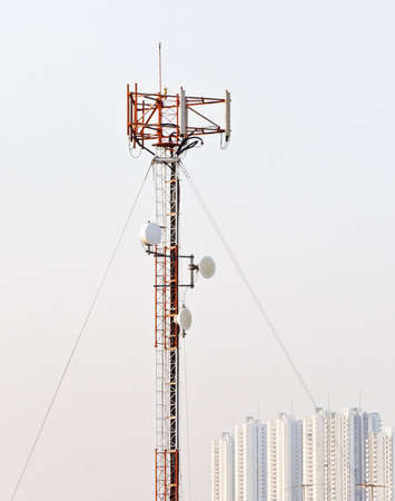 Phone antenna pole stand in the city at evening  Stock Photo - 12391345