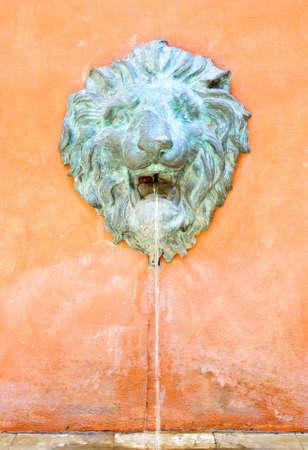 Llion fountain in European style on the orange wall  photo