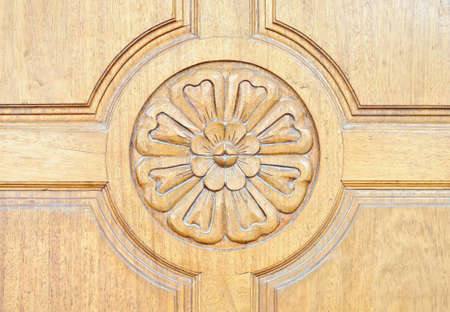 Floral motifs carved on the old wooden doors  photo