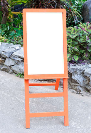 Orange wooden board in front of the small garden Stock Photo - 12391325