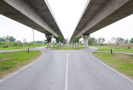 Empty asphalt road under the new expressway line  photo