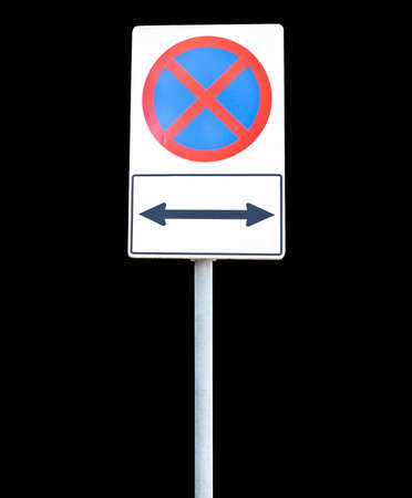 Traffic sign pole on the black background. photo