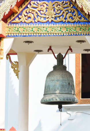 Old black bell hanging on the pavilion of Thai temple. photo