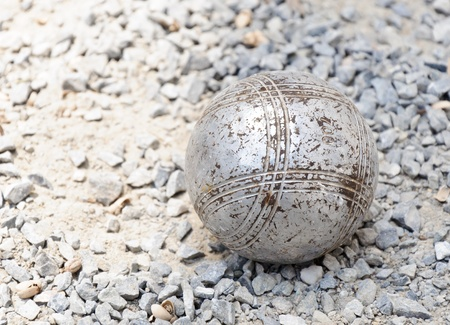 Petanque ball in the match on rock ground  photo
