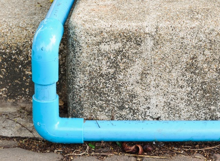 Blue pipe on the ground of car park  photo