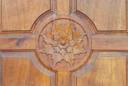 Floral motifs carved on the old wooden doors
