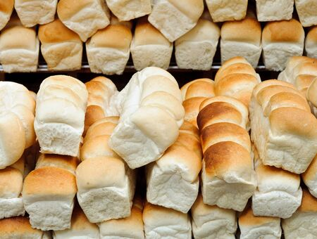 Lot of bread on the shelves of small shop in the zoo  photo