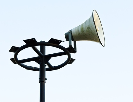 White megaphone on the old pole of station  photo