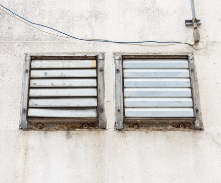 Metal ventilator on the wall of the factory Stock Photo - 13880105