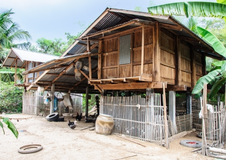 Wooden barn behind the country house of Thai farmer  Stock Photo - 13877341