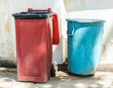 Old bin in front of the white wall in temple  photo