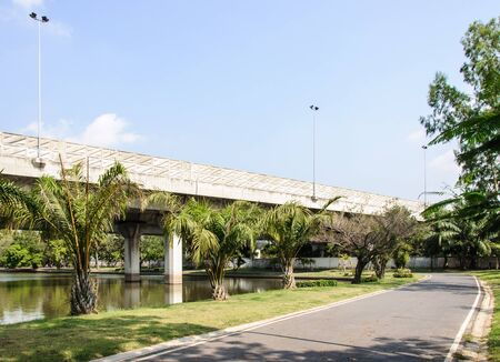 Expressway bridge on the reservoir of urban park  photo