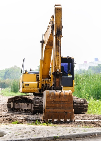 Large excavators were parked in front of the building  photo