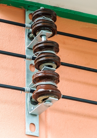 Electric line on the house wall of urban city  photo