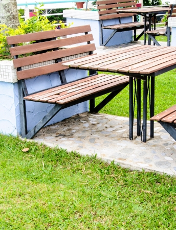 Wooden table set in the garden of hotel photo
