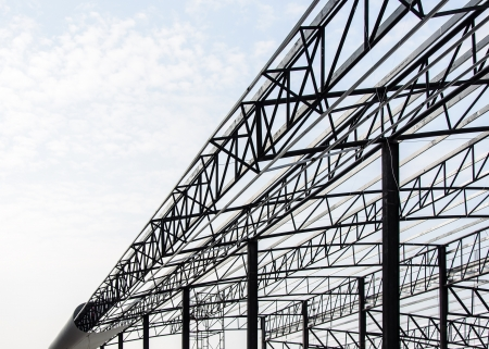 Steel frame of the factory roof in construction  Stock Photo