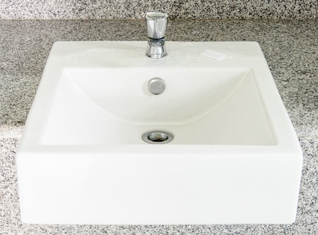 Modern white basin in the restroom of hotel  photo