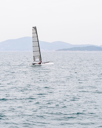 Lonely sailboat on the clear sea in early morning  photo
