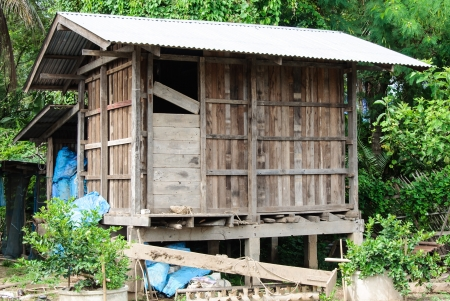 Wooden barn behind the country house of Thai farmer  photo