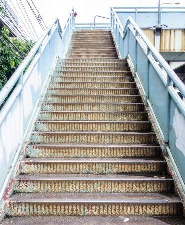 Old metal stairs of the overpass in the city  photo
