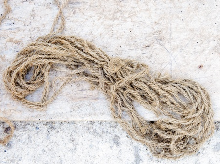 Old hemp rope on the ground of house  photo