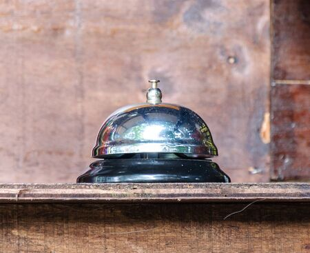 Shiny bell for alarm on the wooden bar in coffee shop  photo