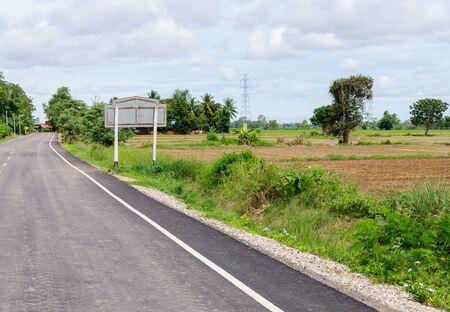 Old asphalt road through the rural village  photo