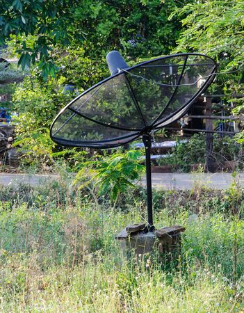 Satellite dish on the field of rural house Stock Photo - 16998782